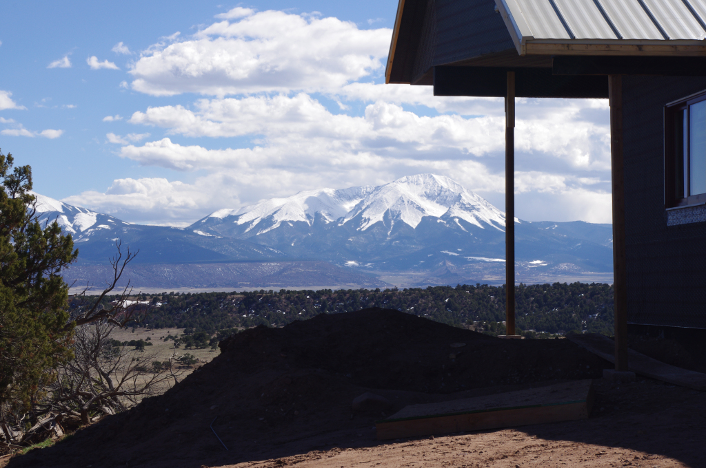 snowy west peak with comanche home in foreground
